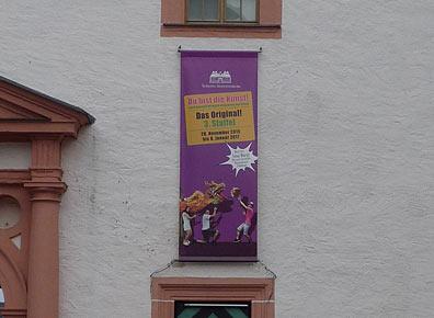 kleienes Banner für Du bist die Kunst auf Schloss Augustusburg